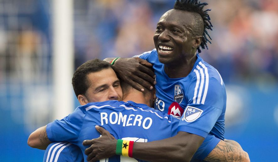 Montreal Impact's Andres Romero, center, celebrates with temamates Dilly Duka, left, and Dominic Oduro after scoring against Real Salt Lake during first-half MLS soccer game action in Montreal, Saturday, May 16, 2015. (Graham Hughes/The Canadian Press via AP) MANDATORY CREDIT