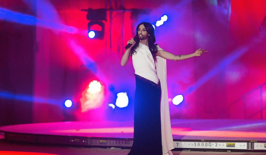 Austrian singer and European Song Contest winner 2014 Conchita Wurst, performs on stage during the opening ceremony of the Life Ball in front of City Hall in Vienna, Austria, Saturday, May 16, 2015. The Life Ball is a charity gala to raise money for people living with HIV and AIDS. (AP Photo/Herwig Prammer)