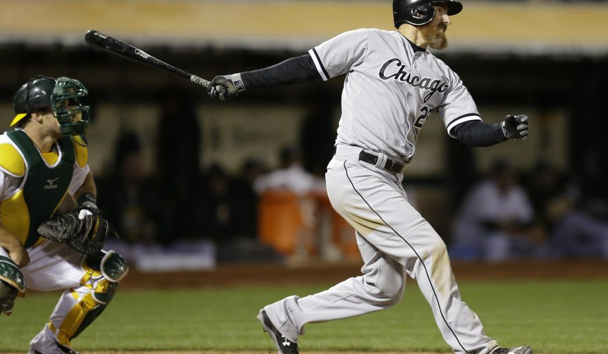 Chicago White Sox's Adam LaRoche follows through on his two-run double hit off Oakland Athletics' Fernando Abad during the seventh inning of a baseball game Friday, May 15, 2015, in Oakland, Calif. (AP Photo/Ben Margot)