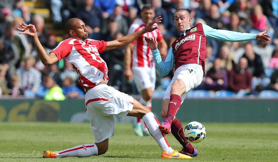 Stoke City's Steven N'Zonzi, left, and Burnley's David Jones compete for the ball during their English Premier League soccer match at Turf Moor, Burnley, England, Saturday, May 16, 2015. (Dave Thompson/PA via AP)   UNITED KINGDOM OUT     -     NO SALES     -     NO ARCHIVES