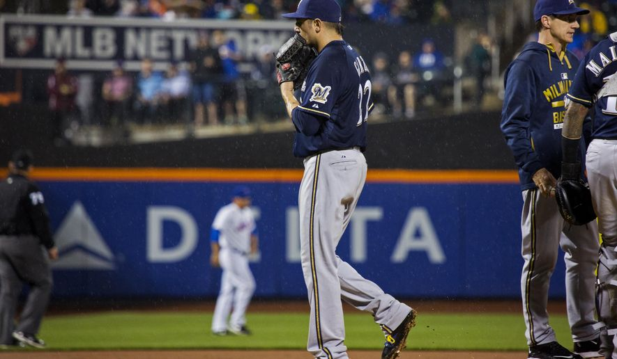 Milwaukee Brewers pitcher Matt Garza is removed from the baseball game against the New York Mets during the fourth inning Saturday, May 16, 2015, in New York. (AP Photo/Craig Ruttle)