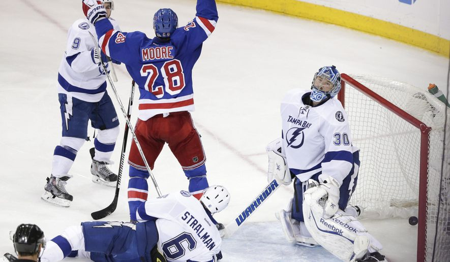 New York Rangers center Dominic Moore (28) celebrates after scoring the game-winning goal past Tampa Bay Lightning goalie Ben Bishop (30) during the third period of Game 1 of the Eastern Conference final during the NHL hockey Stanley Cup playoffs, Saturday, May 16, 2015, in New York. The Rangers won 2-1. (AP Photo/Frank Franklin II)