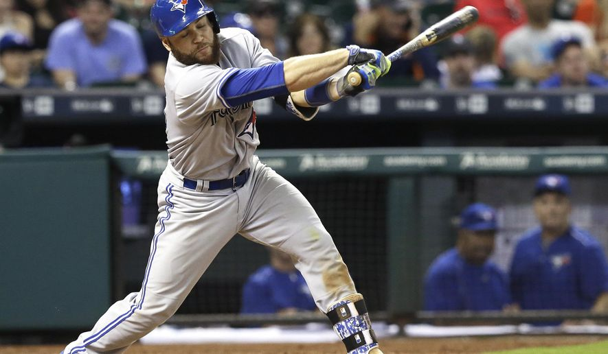 Toronto Blue Jays' Russell Martin swings for strike three against the Houston Astros in the eighth inning of a baseball game Saturday, May 16, 2015, in Houston. (AP Photo/Pat Sullivan)
