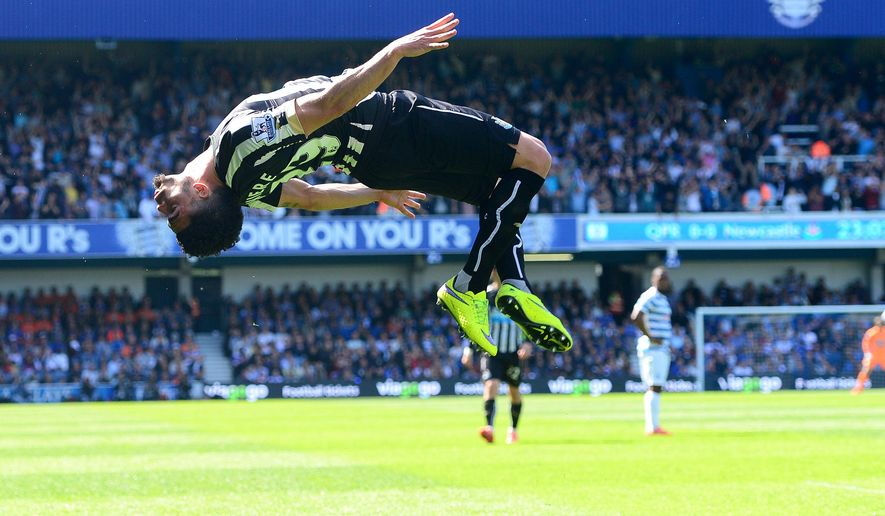 Newcastle United's Emmanuel Riviere does a backflip as he celebrates scoring his side's first goal, during their English Premier League soccer match against Queen's Park Rangers at Loftus Road, London, Saturday, May 16, 2015. (Dominic Lipinski/PA via AP)   UNITED KINGDOM OUT      -      NO SALES      -     NO ARCHIVES