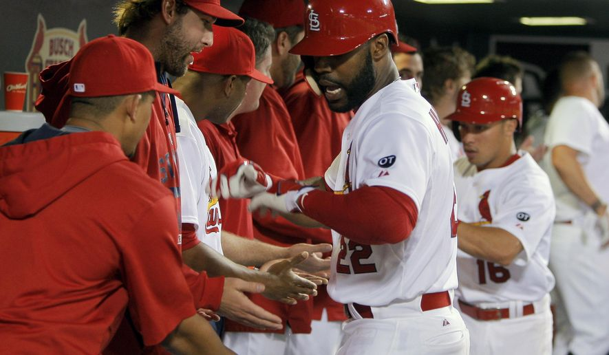 St. Louis Cardinals' Jason Heyward, center, is congratulated by teammates after hitting a two run home run during the eighth inning of a baseball game against the Detroit Tigers Friday, May 15, 2015, in St. Louis. (AP Photo/Scott Kane)
