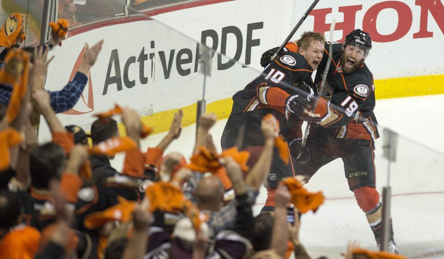 Anaheim Ducks' right wing Corey Perry (10) and teammate Patrick Maroon (19) celebrate Perry's game-winning goal in a 3-2 overtime win against Calgary in Game 5 of a second-round series in the NHL hockey playoffs in Anaheim, Calif., Sunday, May 10, 2015.  Anaheim eliminated Calgary and will face the Chicago Blackhawks in the Western Conference finals. (Michael Goulding/The Orange County Register via AP) LA TIMES OUT MAGS. MANDATORY CREDIT