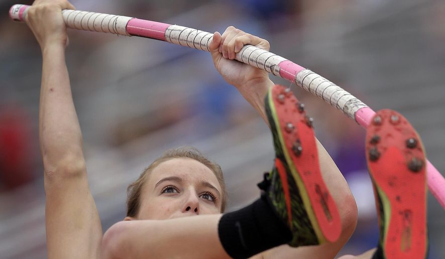 Emory Rains' Charlotte Brown, who is legally blind, competes in the Conference 4A girls pole vault competition at the UIL Texas State Track and Field Championships, Saturday, May 16, 2015, in Austin, Texas. Brown won a Bronze medal with her third place finish. (AP Photo/Eric Gay)
