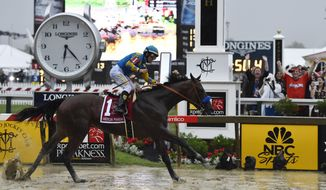 American Pharoah, ridden by Victor Espinoza, wins the 140th Preakness Stakes horse race at Pimlico Race Course, Saturday, May 16, 2015, in Baltimore. (AP Photo/Mike Stewart)