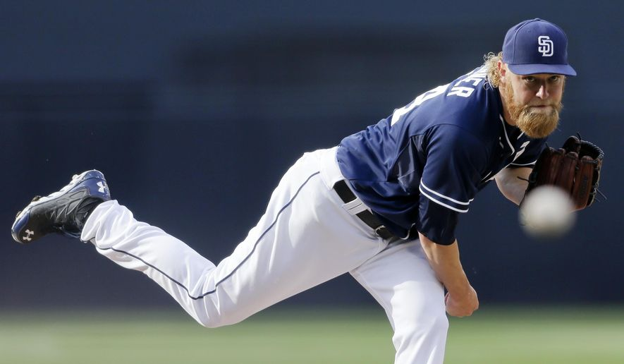 San Diego Padres starting pitcher Andrew Cashner throws to a Washington Nationals batter during the first inning of a baseball game Saturday, May 16, 2015, in San Diego. (AP Photo/Gregory Bull)