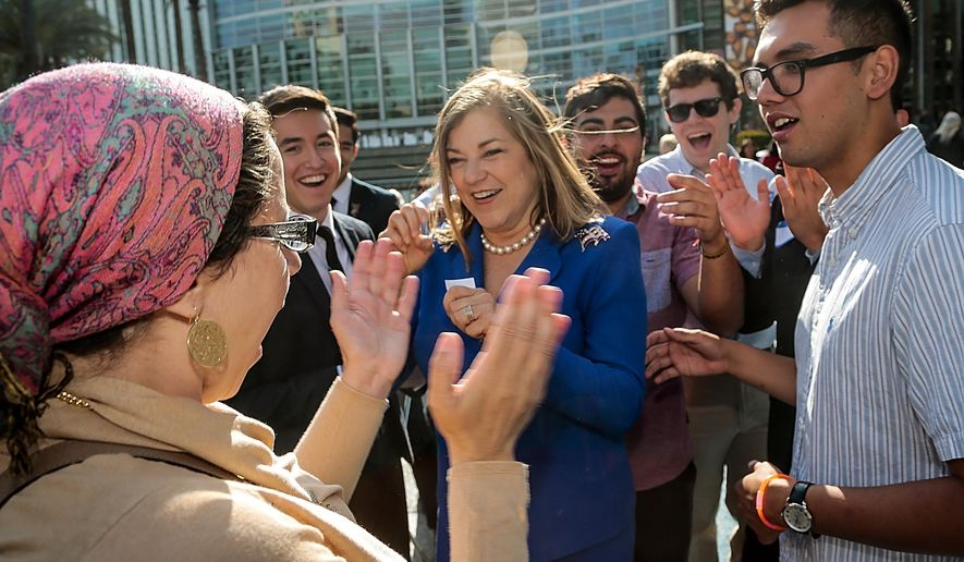 California Rep. Loretta Sanchez, middle, greets supporters at the California Democrats State Convention in Anaheim, Calif., on Saturday, May 16, 2015. (AP Photo/Damian Dovarganes)
