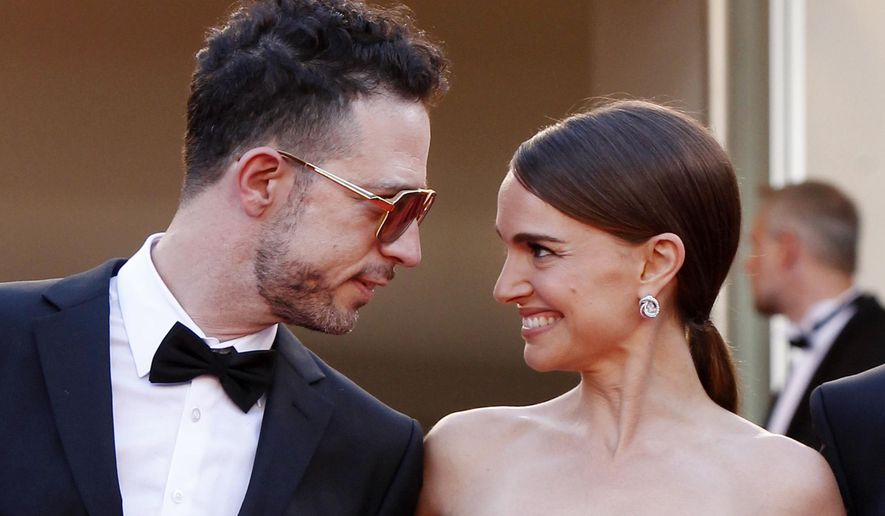 The cast of A Tale of Love and Darkness, singer Gilad Kahana, left, and director Natalie Portman look to each other as they arrive for the screening of the film Mia Madre (My Mother) at the 68th international film festival, Cannes, southern France, Saturday, May 16, 2015. (AP Photo/Lionel Cironneau)