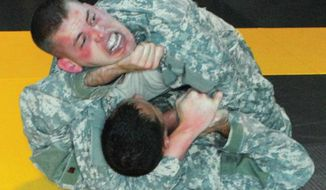 U.S. Army officers engage in a combatives tournament held at Fort Benning, Ga. (Image: U.S. Army) ** FILE **