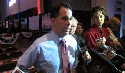 Gov. Scott Walker takes questions before his speech at the Wisconsin Republican Party convention on Saturday, May 15, 2015, in La Crosse, Wis. (AP Photo/Scott Bauer) ** FILE **