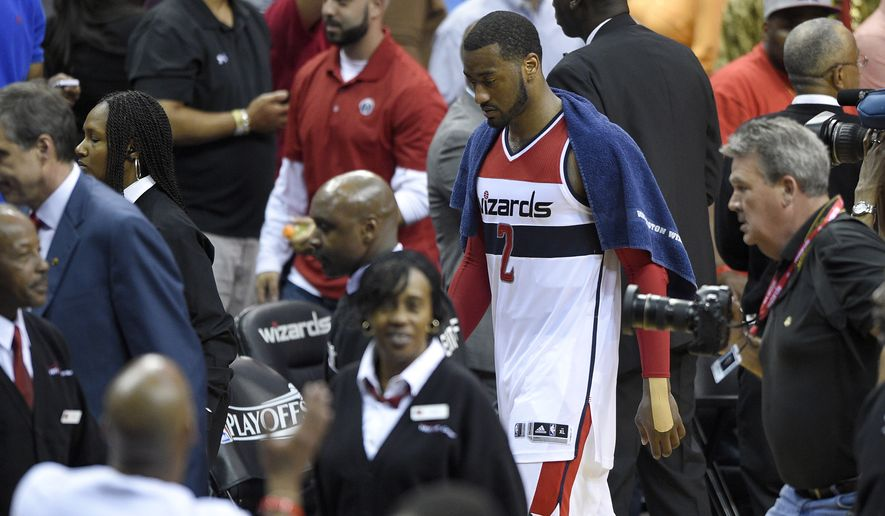Washington Wizards guard John Wall (2) walks off the court after losing 94-91 to the Atlanta Hawks in Game 6 of the second round of the NBA basketball playoffs, Friday, May 15, 2015, in Washington. (AP Photo/Nick Wass)