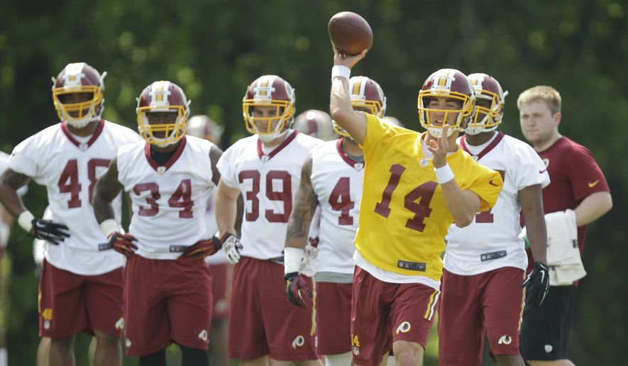 Washington Redskins quarterback Anthony Neyer (14) throws a pass as teammates look on during NFL foootball rookie minicamp, Saturday, May 16, 2015, at Redskins Park in Ashburn, Va. (AP Photo/Luis M. Alvarez)