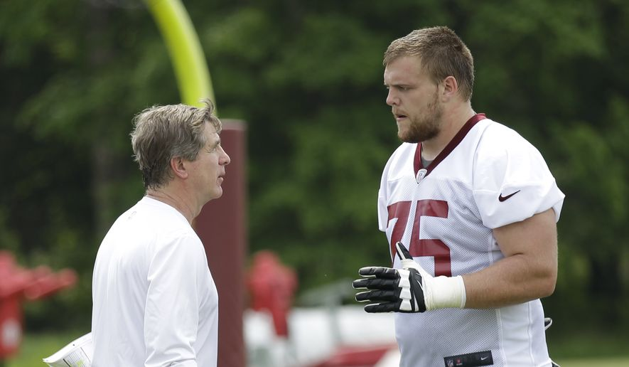 Washington Redskins offensive lineman and first round draft pick Brandon Scherff, right, talk to offensive Line coach  Bill Callahan, left, after NFL football rookie minicamp, Saturday, May 16, 2015, at Redskins Park in Ashburn, Va. (AP Photo/Luis M. Alvarez)
