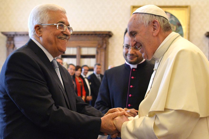 """Pope Francis meets Palestinian leader Mahmoud Abbas during an audience at the Vatican Saturday, May 16, 2015. Pope Francis has praised Palestinian President Mahmoud Abbas as an """"angel of peace"""" during a meeting at the Vatican. Francis made the compliment Saturday during the traditional exchange of gifts at the end of an official audience in the Apostolic Palace. (Alberto Pizzoli/Pool Photo via AP)"""