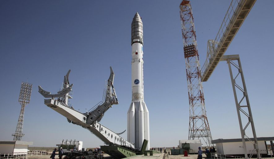 In this photo taken Tuesday, May 13, 2014, a Proton-M rocket is installed at Baikonur launch pad in Kazakhstan. A Russian rocket, Proton-M, carrying a Mexican satellite malfunctioned Saturday shortly after its launch, the latest mishap to hit Russia's troubled space industry, whose Soviet-era glory has been tarnished by a series of launch failures. (Roscosmos via AP)