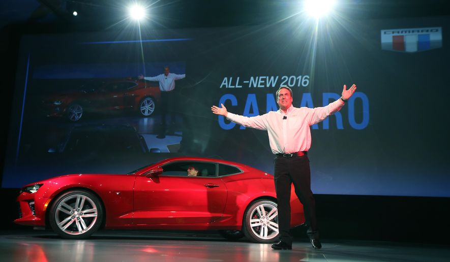 General Motors Executive Vice President for Global Product Development, Mark Reuss, stands in front of the new 2016 Chevrolet Camaro unveiled during a news conference on Belle Isle Park in Detroit on Saturday, May 16, 2015. The Camaro made its debut in 1967 as GM's answer to the wildly popular Ford Mustang. (AP Photo/Carlos Osorio)