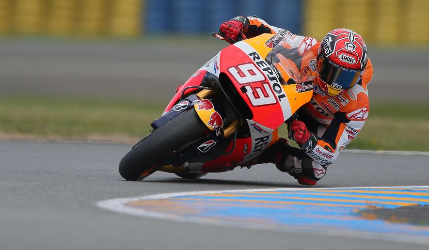 Spanish Moto GP rider Marc Marquez competes during the free practice session of the MotoGP World Championship at the Bugatti race track in Le Mans, western France, Friday, May 15, 2015. The race will start Sunday, May 17. (AP Photo/David Vincent)