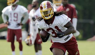 Washington Redskins running back and third-round draft pick Matt Jones runs during NFL football rookie minicamp, Saturday, May 16, 2015, at Redskins Park in Ashburn, Va. (AP Photo/Luis M. Alvarez)