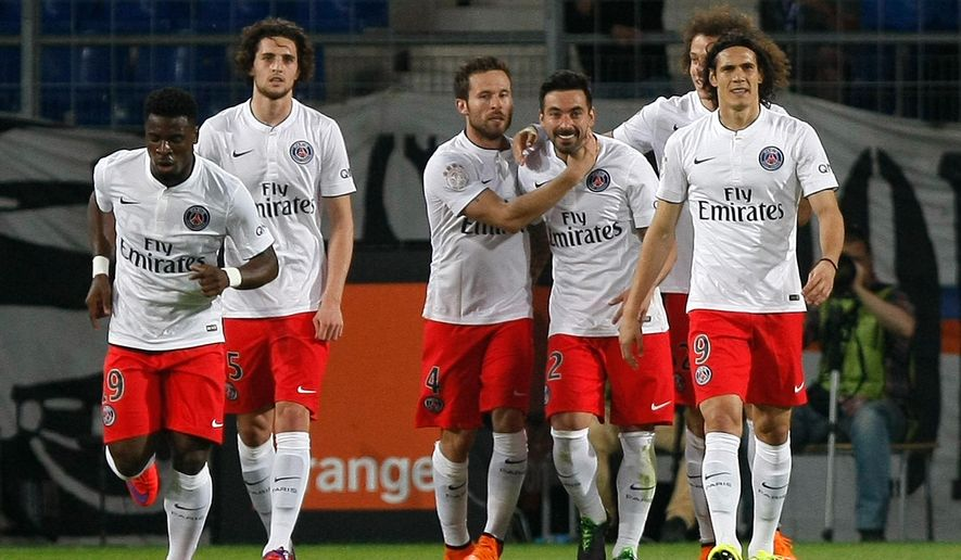 Paris Saint Germain's Argentinian forward Ezequiel Lavezzi,  third right,  celebrates after scoring against Montpellier, during the League One soccer match between Montpellier and Paris Saint-Germain, at the La Mosson Stadium, in Montpellier, southern France, Saturday, May 16, 2015. (AP Photo/Claude Paris)