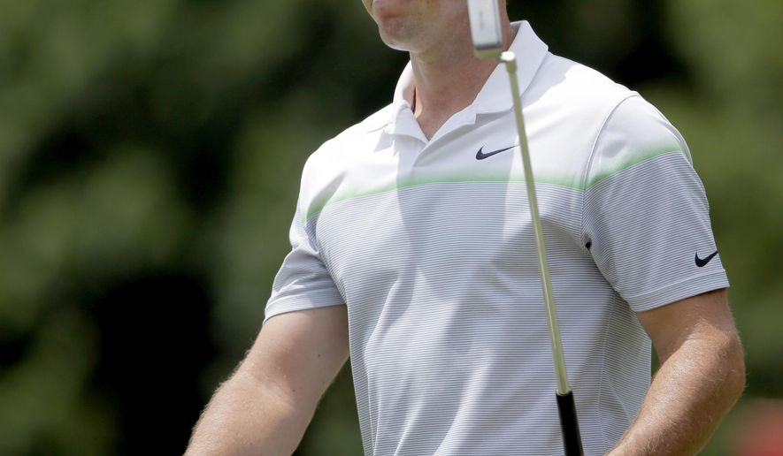 Rory McIlroy, of Northern Ireland, reacts after making birdie on the fifth hole during the third round of the Wells Fargo Championship golf tournament at Quail Hollow Club in Charlotte, N.C., Saturday, May 16, 2015. (AP Photo/Chuck Burton)