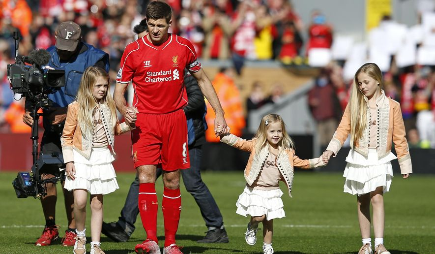 Liverpool's Steven Gerrard walks on the pitch with his daughters ahead of the English Premier League soccer match between Liverpool and Crystal Palace at Anfield Stadium, Liverpool, England, Saturday, May 16, 2015. Gerard will play his final home match for Liverpool on Saturday at Anfield after over 700 appearances for the club, before he moves to MLS team LA Galaxy. (AP Photo/Jon Super)