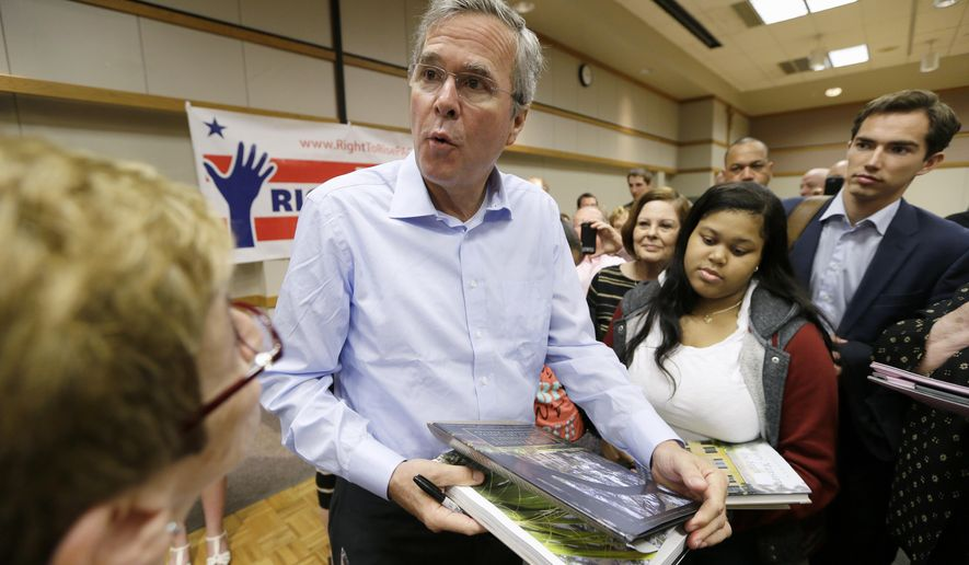 Former Florida Gov. Jeb Bush signs autographs following a town hall meeting, Saturday, May 16, 2015, at Loras College in Dubuque, Iowa. (AP Photo/Charlie Neibergall)
