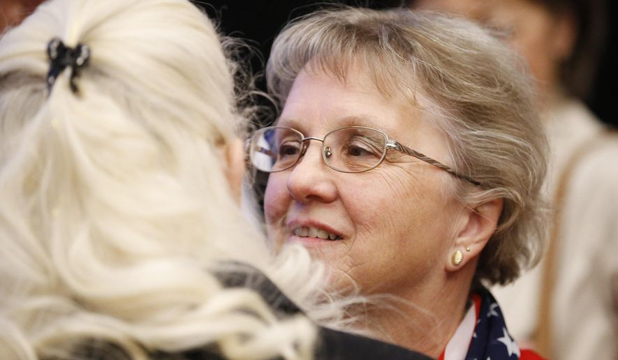 FILE - In this Nov 4 2014 file photo, Arizona Republican candidate for State Superintendent Diane Douglas, right, talks with a supporter at the Republican election night party in Phoenix.  Douglas filed a motion late Friday, May 15, 2015 in Maricopa County Superior Court against the Board of Education, its president and executive director. Douglas is requesting a judge clarify her authority over Board of Education employees. The filing comes after 11 employees moved to other offices last week and are allegedly refusing her leadership. (AP Photo/Ross D. Franklin)