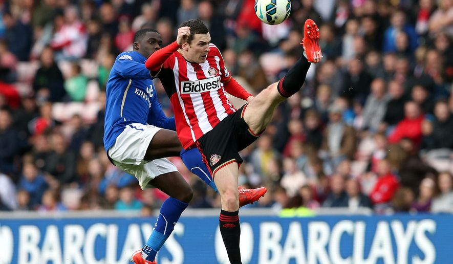 Sunderland's Adam Johnson, right, vies for the ball with Leicester City's Jeff Schlupp, left,  during their English Premier League soccer match between Sunderland and Leicester City at the Stadium of Light, Sunderland, England, Saturday, May 16, 2015. (AP Photo/Scott Heppell)