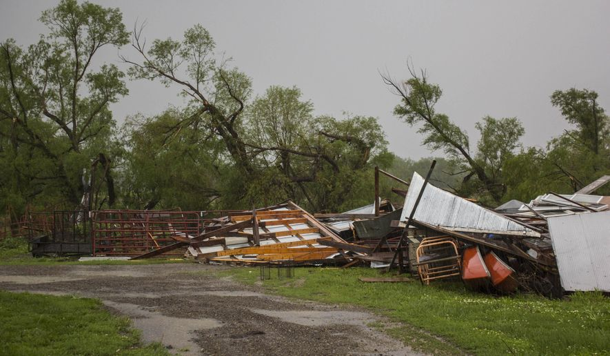 Storms moved through rural Lyon County, Kan., Saturday, May 16, 2015. Another round of strong storms, including some tornadoes, is moving across the nation's midsection. Storms were also moving across parts of Texas, Kansas, Nebraska and Minnesota, where there were some reports of tornadoes. (Matthew Fowler/Emporia Gazette via AP)