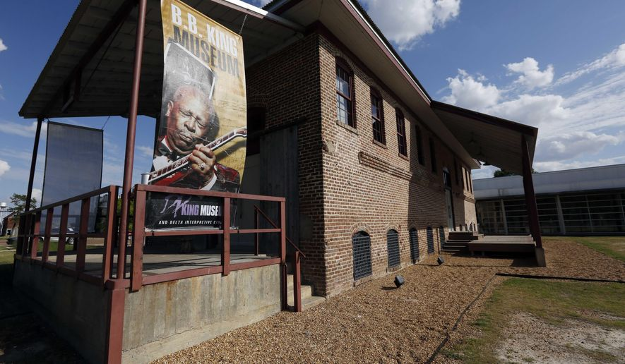In this photo taken May 6, 2015,  an oversized poster of B.B. King oversees the converted cotton gin warehouse at the B.B. King Museum in Indianola, Miss. King claimed Indianola as his hometown after moving there as a teenager. King died Thursday night, May 14, 2015, at age 89 in Las Vegas, where he had been in hospice care. (AP Photo/Rogelio V. Solis)