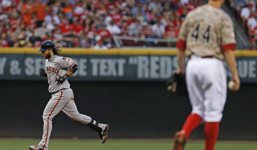 San Francisco Giants' Brandon Crawford (35) runs the bases after hitting a grand slam off Cincinnati Reds starting pitcher Mike Leake (44) during the fifth inning of a baseball game Saturday, May 16, 2015 in Cincinnati. (AP Photo/Gary Landers)