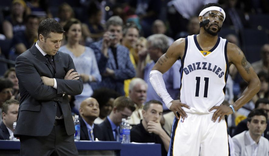 Memphis Grizzlies coach David Joerger and guard Mike Conley (11) wait near the end of Game 6 of a second-round NBA basketball Western Conference playoff series against the Golden State Warriors, Friday, May 15, 2015, in Memphis, Tenn. The Warriors won 108-95 to win the series 4-2. (AP Photo/Mark Humphrey)