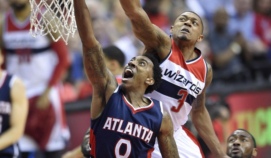 Atlanta Hawks guard Jeff Teague (0) goes to the basket against Washington Wizards guard Bradley Beal (3) in the first half of Game 6 of the second round of the NBA basketball playoffs, Friday, May 15, 2015, in Washington. The Hawks won 95-91. (AP Photo/Nick Wass)