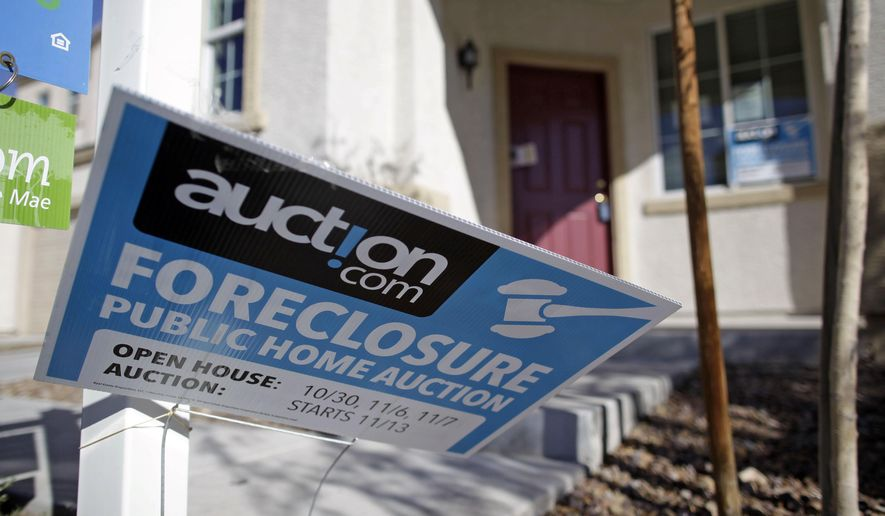 FILE - This Nov. 17, 2010 file photo, shows a sign in front of a foreclosed home in Las Vegas. Nevada lawmakers want to pull the plug on a program that helps homeowners fend off foreclosure in a sign of just how far the state has come since the Great Recession. Legislators are moving to phase out the Foreclosure Mediation Program that was born in 2009 and brings lenders and troubled borrowers to the negotiating table. (AP Photo/Julie Jacobson, File)