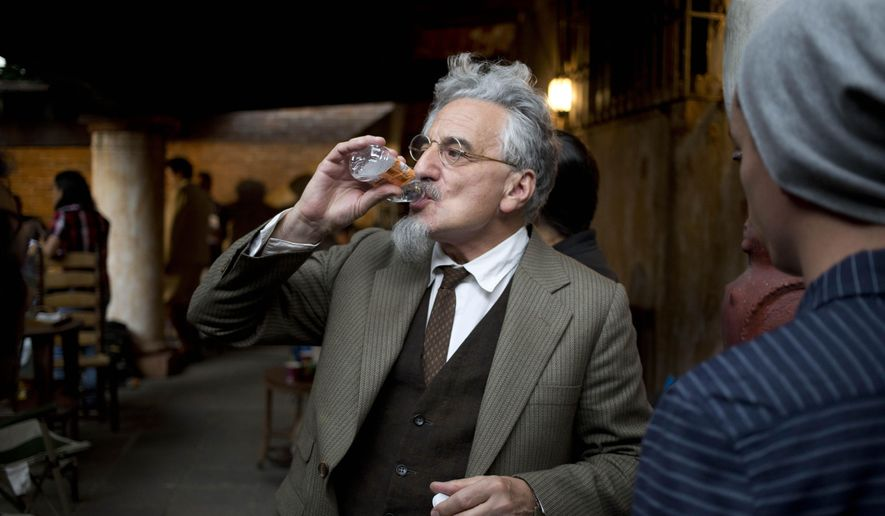 """In this April 22, 2015 photo, British stage veteran Henry Goodman, who plays the part of Leon Trotsky, sips water before a press conference on the set of the film """"El Elegido,"""" or """"The Chosen,"""" in Mexico City. The plot to assassinate Leon Trotsky, the Soviet revolutionary-turned-exiled dissident, in Mexico City in 1940, is at the heart of """"El Elegido"""" (""""The Chosen""""), an upcoming movie that's set to wrap shooting in this capital in the coming days. (AP Photo/Eduardo Verdugo)"""