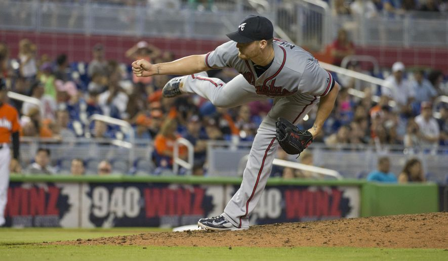 Atlanta Braves starting pitcher Shelby Miller throws to the Miami Marlins during the eighth inning of a baseball game in Miami, Sunday, May 17, 2015. The Braves won 6-0. (AP Photo/J Pat Carter)