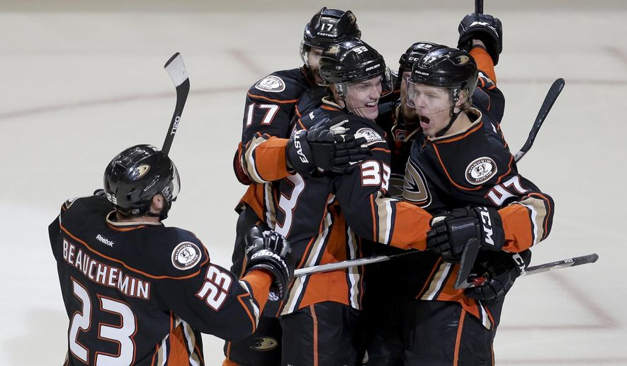Anaheim Ducks defenseman Hampus Lindholm (47) celebrates with teammates after scoring against the Chicago Blackhawks during the first period of Game 1 of the Western Conference final during the NHL hockey Stanley Cup playoffs in Anaheim, Calif., Sunday, May 17, 2015. (AP Photo/Chris Carlson)