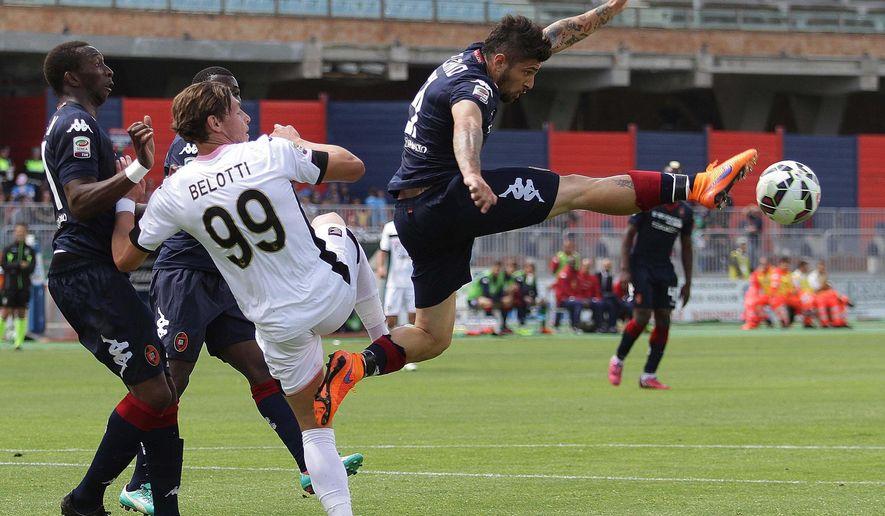 Cagliari's Antonio Balzano reaches for the ball during a Serie A soccer match between Cagliari and Palermo at the Sant'Elia Stadium in Cagliari, Italy, Sunday, May 17, 2015. Guseppe Ungari/ANSA via AP)