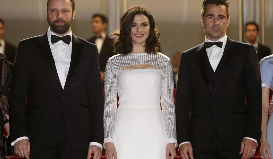 From left, director Yorgos Lanthimos, poses alongside actors Rachel Weisz, and Colin Farrell as they arrive for the screening of the film The Lobster at the 68th international film festival, Cannes, southern France, Friday, May 15, 2015. (AP Photo/Lionel Cironneau)