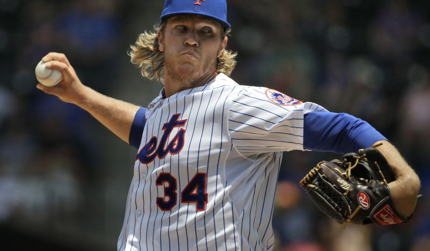 New York Mets starting pitcher Noah Syndergaard throws during the first inning of a baseball game against the Milwaukee Brewers, Sunday, May 17, 2015, in New York. (AP Photo/Seth Wenig)