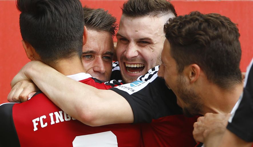 Ingolstadt's Stefan Lex, background left, celebrates with teammates after scoring his side's second goal during the German second division Bundesliga soccer match between FC Ingolstadt and RB Leipzig at the Audi Sportpark in Ingolstadt, Germany, on Sunday, May 17, 2015. (AP Photo/Matthias Schrader)