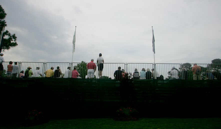 Spectators watch golfers on the 18th hole during the final round of the LPGA Tour's Kingsmill Championship golf tournament on Sunday, May 17, 2015, in Williamsburg, Va. (AP Photo/Jason Hirschfeld)