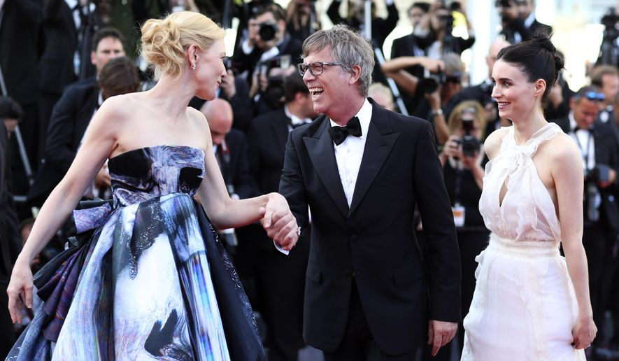 From left, actress Cate Blanchett, director Todd Haynes, and actress Rooney Mara poses for photographers upon arrival for the screening of the film Carol at the 68th international film festival, Cannes, southern France, Sunday, May 17, 2015. (AP Photo/Thibault Camus)