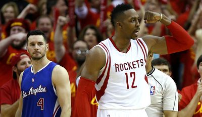 Houston Rockets center Dwight Howard (12) reacts to a play as Los Angeles Clippers guard J.J. Redick (4) looks on during the fourth quarter of Game 7 of the NBA Western Conference semifinals at the Toyota Center Sunday, May 17, 2015, in Houston.  ( James Nielsen / Houston Chronicle via AP )MANDATORY CREDIT