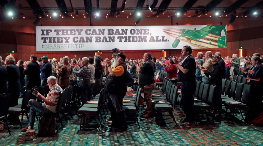 National Rifle Association members applaud a speech during the annual meeting of members at the organization's Nashville, Tennessee, convention in April. The NRA is planning a major voter-outreach program for the 2016 presidential election, hoping to capitalize on Americans' growing belief that gun ownership will make them safer. (Associated Press)