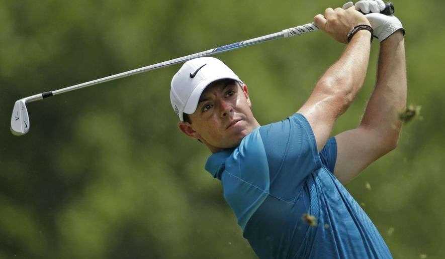 Rory McIlroy, of Northern Ireland, watches his tee shot on the second hole during the final round of the Wells Fargo Championship golf tournament at Quail Hollow Club in Charlotte, N.C., Sunday, May 17, 2015. (AP Photo/Chuck Burton)
