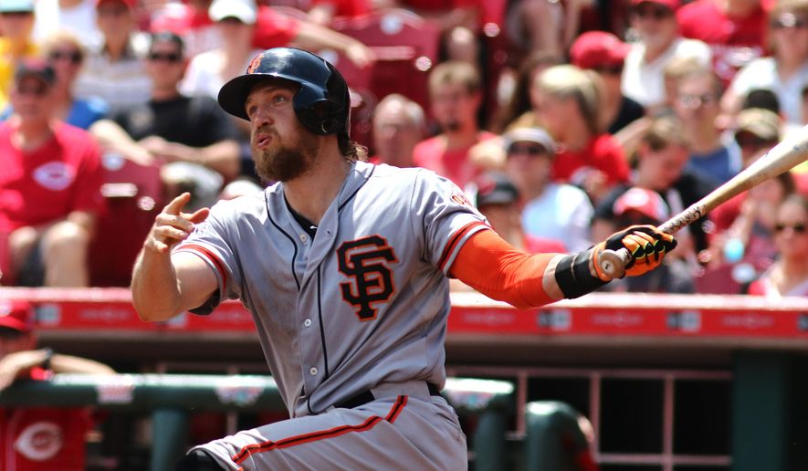 San Francisco Giants Hunter Pence hits a two run home run against the Cincinnati Reds in the third inning of a baseball game in Cincinnati, Sunday, May 17, 2015. (AP Photo/Tom Uhlman)